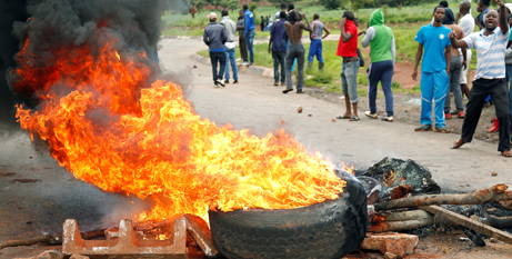 Zimbabweans in Harare protest against steep fuel price hikes (CNS photo/Philimon Bulawayo, Reuters)