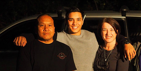 Joshua Tam (centre) with his parents, John and Julie (Facebook)