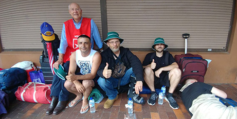 Community Care Van volunteer Frank Zipfinger (in red vest) distributes items to help the homeless cope with the heat (Order of Malta Australia)