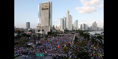 Pilgrims gather along the Cinta Costera area of Panama City during the opening Mass of World Youth Day (CNS/Carlos Jasso, Reuters)