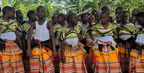 Children from St Joseph's, Masaka, in traditional dress welcome visitors from Australia (The Catholic Leader)
