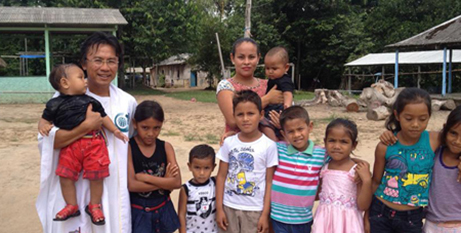 Fr Manh Le SVD with a family in Brazil (In the Word)