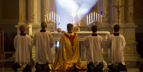 Priests kneel before the Blessed Sacrament (CNS/Christopher Riggs)
