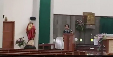A screenshot of footage showing a man with a sword in the Yogyakarta church yesterday (ABC News)