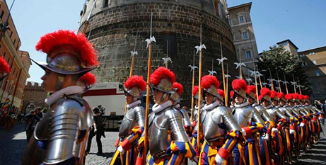 Swiss Guards march past the the Vatican Bank (CNS/Tony Gentile, Reuters)