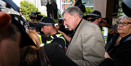 Cardinal George Pell leaves court yesterday (CNS/James Ross, Reuters)