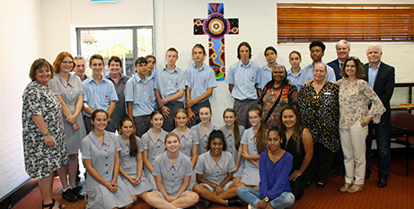 Students and staff from Notre Dame and Prendiville with the Manjaree Cross