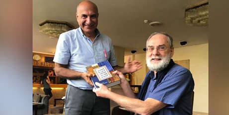 Reverend Riad Kassis and Pieter Kwant of Langham Partnership, with a copy of the new Arabic Contemporary Bible Commentary (Hope 103.2)