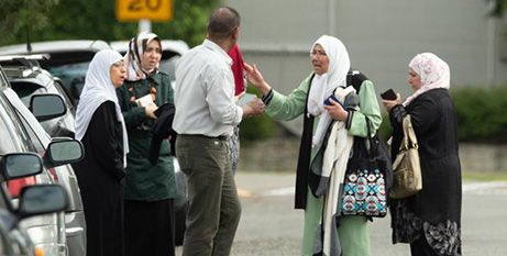 Members of a family react outside the Al Noor Mosque in Christchurch, New Zealand on Friday (CNS/Martin Hunter, Reuters)