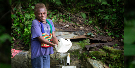 Peter collects water from a well about a kilometre from his Solomon Islands boarding school (Caritas Australia/Cassandra Hill)