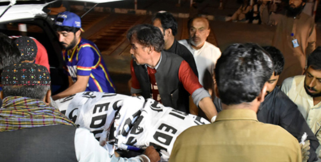 One of the victims is placed into an ambulance, Monday (CNS/Naseer Ahmed)