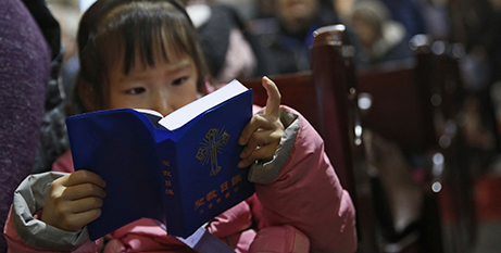 Reading a  bible in a state-approved Catholic cathedral in Beijing, 2016 (CNS/How Hwee Young/EPA)