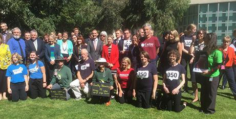 Charities gathered at the Senate Courtyard in March to flag problems with the initial bill (Twitter/350Australia)