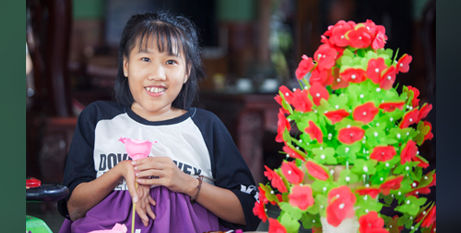 Nguyet with some of her creative works (Caritas Australia-/Nguyen Minh Dinc)