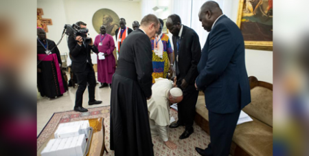 Pope Francis kneels at the feet of the Sudanese leaders at Domus Sanctae Marthae, Vatican,  yesterday (CNS/Vatican Media via Reuters)