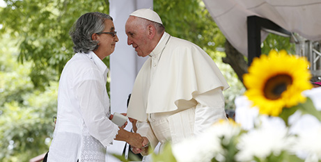 Pope Francis meets a Columbian woman on his Latin American trip last year (CNS/Paul Haring)