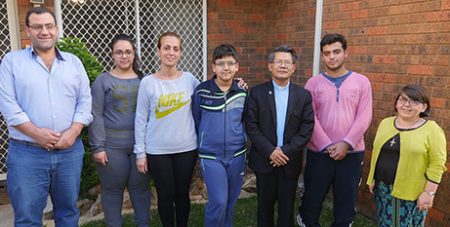 Bishop Vincent Long meets with the Syrian family (Catholic Outlook)