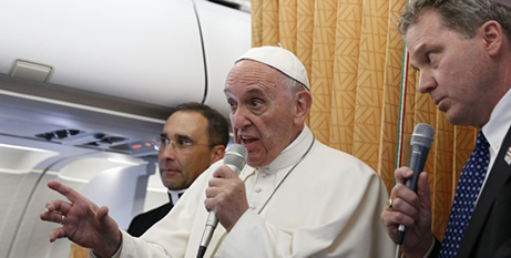 Pope Francis answers questions on the papal plane in April (CNS)