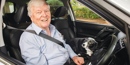 Bishop Greg O'Kelly SJ with his dog Jezabel (The Southern Cross/Nat Rogers)