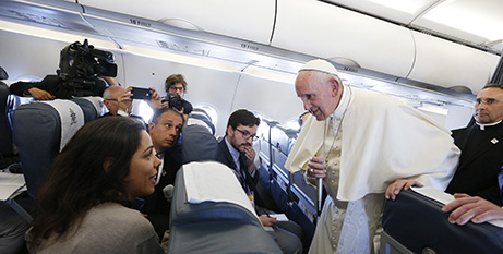 Pope Francis speaks with journalists on the papal plane (CNS/Paul Haring)