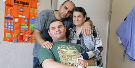 Masoud Abdollah Pouri, his brother Edris and mother Fatemeh (The Catholic Leader)