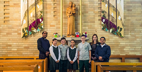Fr Jose Manjaly and school representatives with a statue of St Anthony (Alphonsus Fok)