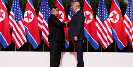 Kim Jong-Un and Donald Trump at the summit on Tuesday(CNS/Reuters)