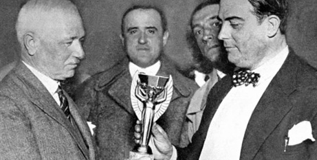 Jules Rimet (left) presents the first World Cup trophy to a representative of Uruguay in 1930 (Catholic Herald)