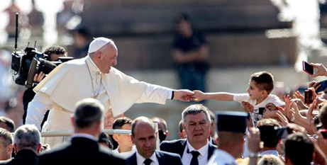 Pope Francis greets pilgrims in St Peter's Square yesterday (CNA/Daniel Ibañez)