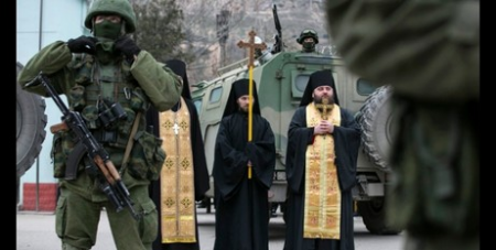 Clergy pray next to soldiers