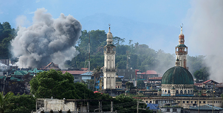 Airstrike in Marawi, Philippines, July (CNS/Jorge Silva, Reuters)