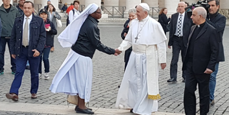 Pope Francis meets a religious sister in St Peter