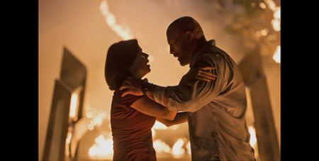 Neve Campbell (left) and Dwyane Johnson star in Skyscraper (CNS/Universal)
