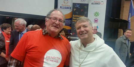 Archbishop Anthony Fisher OP and a forum attendee (Facebook)
