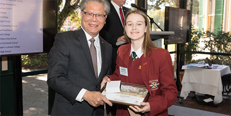 Laura Cassell from Xavier College receives her award from the South Australian Governor Hieu Van Le (The Southern Cross)
