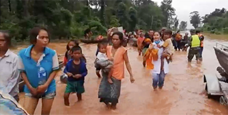 Villagers wade through flood waters in south-eastern Laos (ABC News screenshot)