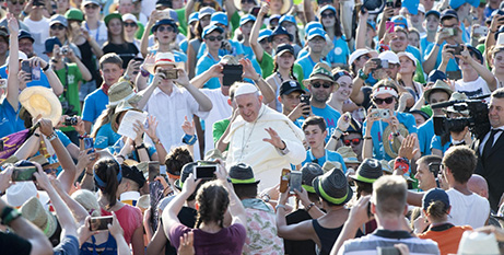 Pope Francis greets altar servers gathered at the Vatican yesterday (CNS/Claudio Peri, EPA)