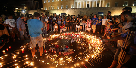 People gather in Athens to remember the victims of the wildfires (CNS/Alexandros Beltes, EPA)