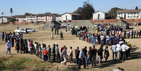 People line up in Harare to cast their votes in the July 30 election (CNS/Siphiwe Sibeko, Reuters)
