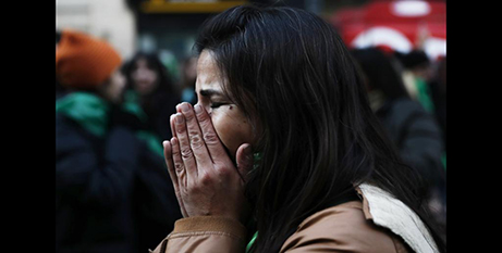 A woman in Buenos Aires reacts after the lower house approved the abortion bill in June  (CNS/David Fernandez, EPA)