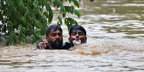 A man is rescued yesterday  near Cochin, India (CNS/Sivaram V, Reuters)