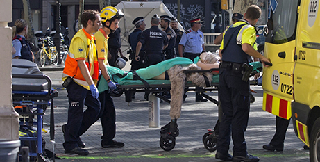 Medics attend to a person injured in the attack (CNS/Quique Garcia, EPA)