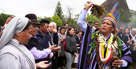 Shaman Isidoro Jajoy blesses attendees of the preparatory meeting in Bogota, Colombia, for the October Synod of Bishops for the Amazon (CNS/Manuel Rueda)