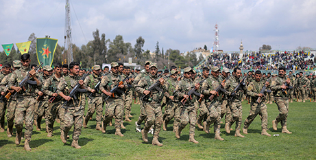 -Kurdish fighters in Qamishli, Syria, in a military parade in March (CNS/Rodi Said, Reuters)