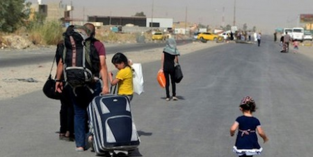 Iraq family fleeing Mosul