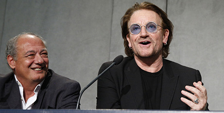 Bono (right) and Jose Maria del Corral at the Vatican yesterday (CNS/Paul Haring)
