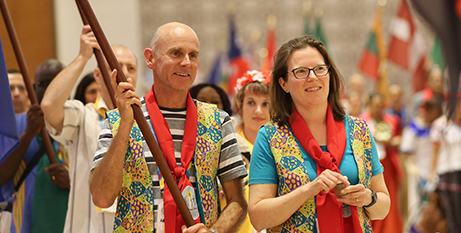 Mark and Sarah Stoove were flag bearers for Australia at the gathering's opening ceremony (Catholic Voice/Supplied)