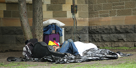 A homeless person outside Melbourne's St Paul's Cathedral (Bigstock)