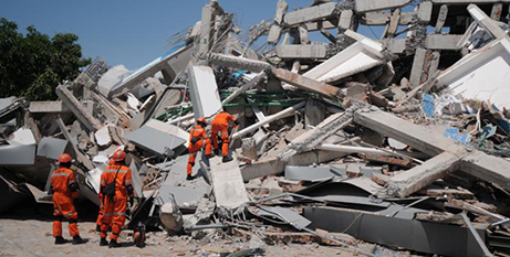 A rescue team searches for victims in a destroyed hotel in Sulawesi, Indonesia (CNS/Antara Foto, Reuters)