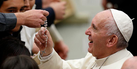 Pope Francis touches Rosary beads at a general audience in November 2017 (CNS/Paul Haring)